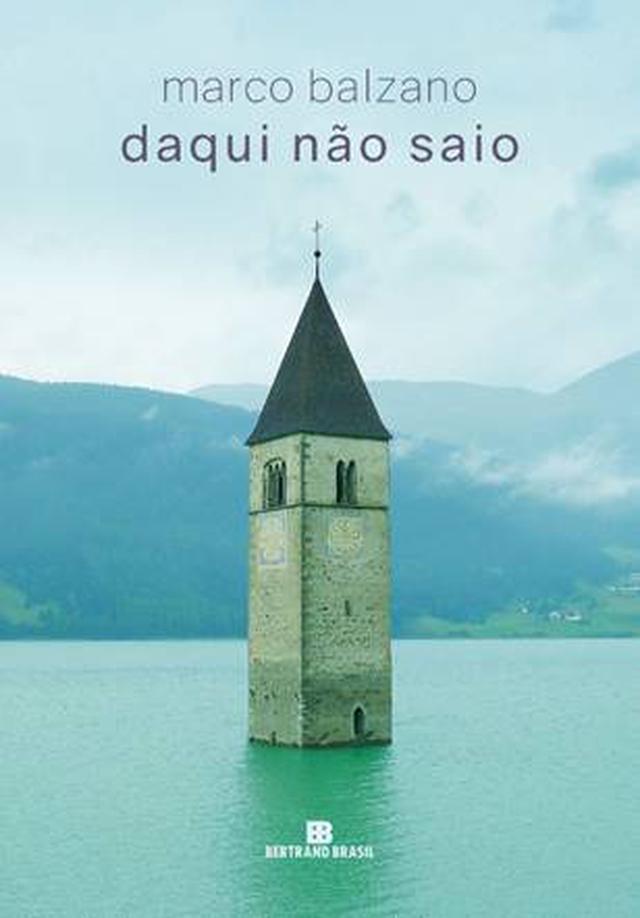 """Capa do livro """"Daqui não saio"""" retrata uma torre saindo da água de um lago"""