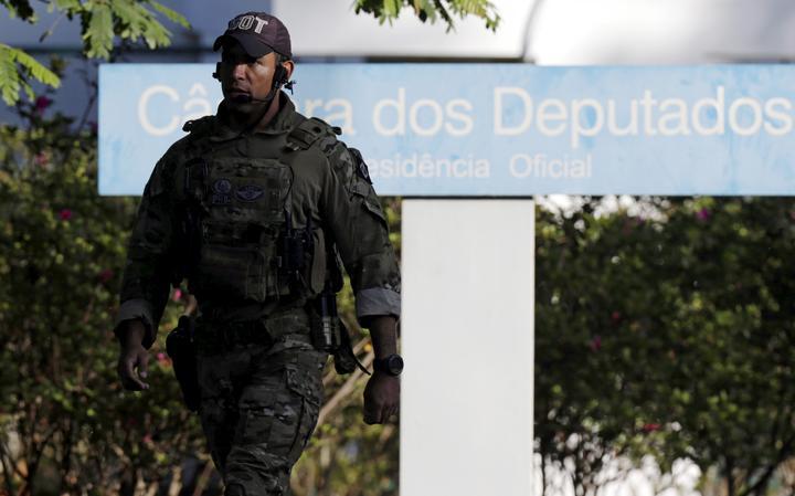 Agente da PF na casa de Cunha
