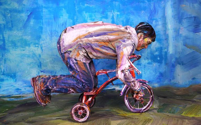 Pintura de um homem em triciclo (junho, 2018)