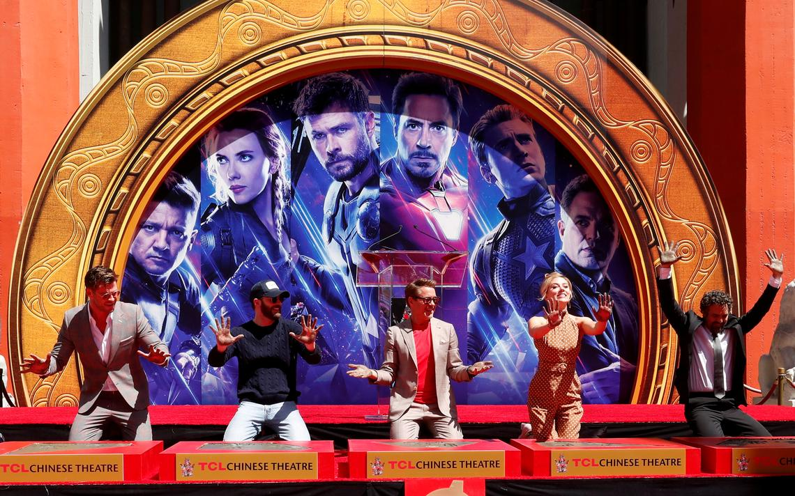 Actors Chris Hemsworth, Chris Evans, Robert Downey Jr., Scarlett Johansson and Mark Ruffalo show their hands after placing their handprints in cement at a ceremony at the TCL Chinese Theatre in Hollywood, Los Angeles,California, U.S. April 23, 2019. REUTERS/Mario Anzuoni