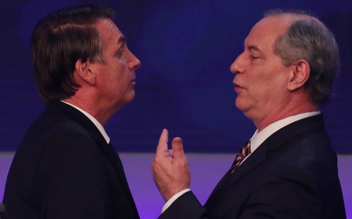 Bolsonaro e Ciro durante debate na TV Bandeirantes
