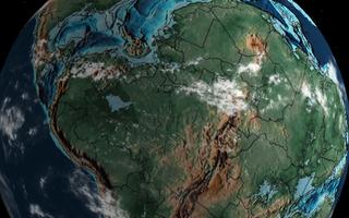 Porção do planeta Terra mostra áreas continentais em tons de verde e marrom e oceanos em azul