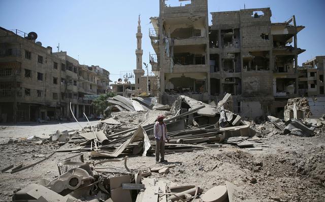 Capital da Síria tem prédios destruídos por causa da guerra